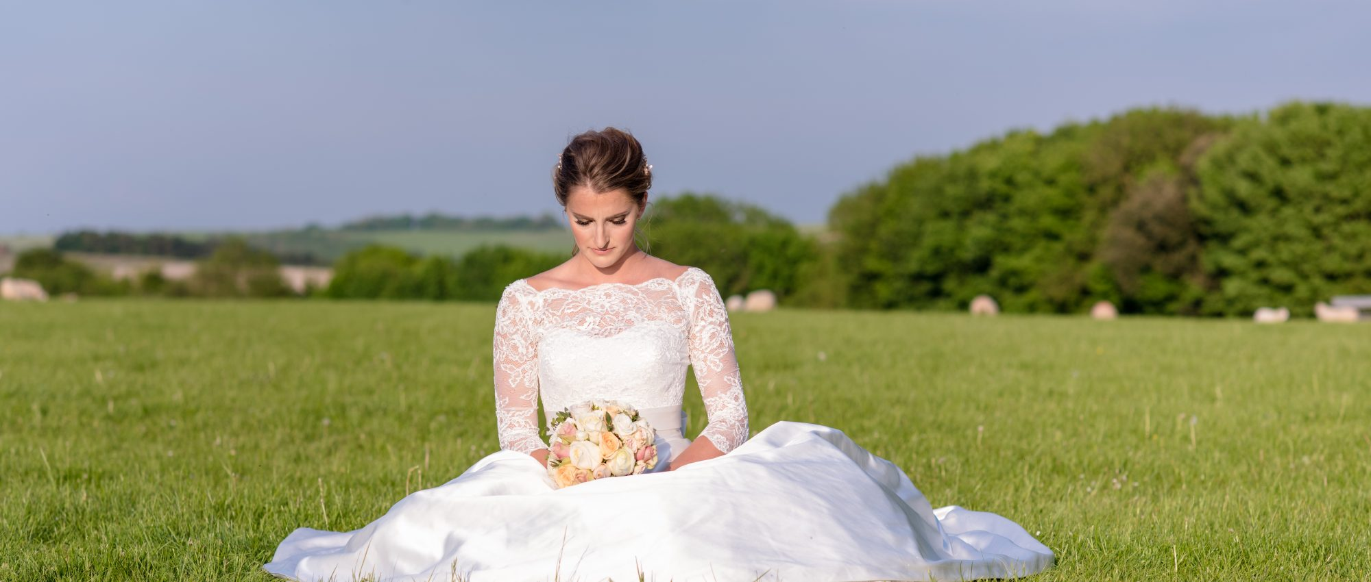 Wedding shot of bride in field